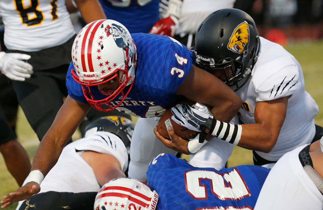 Liberty's Treyveon Campbell (34) plays against Saguaro's Antonio Cuevas, left, during the first quarter of a football game at Liberty High School in Henderson, Saturday, Aug. 26, 2017. Chitose Suz ...