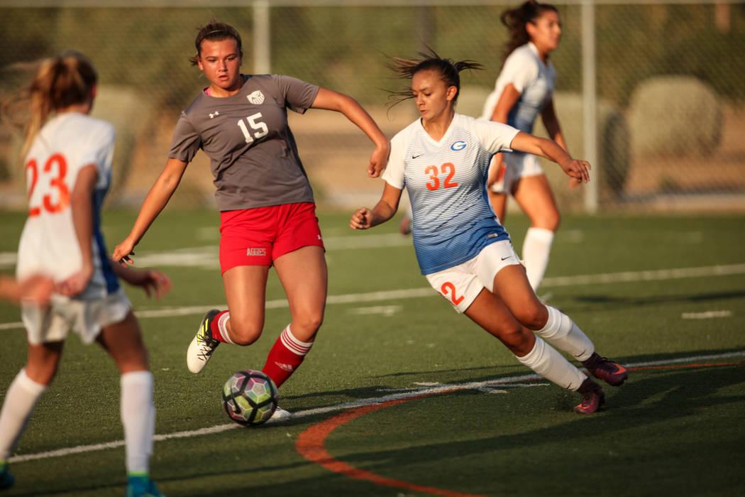 Arbor View High School's Jolianna Meyers, 15, dribbles past Bishop Gorman's Alexa Fehlman, 32, during a game at Bishop Gorman High School in Las Vegas on Aug. 31, 2017. Bishop Gorman won 4-3. Joel ...