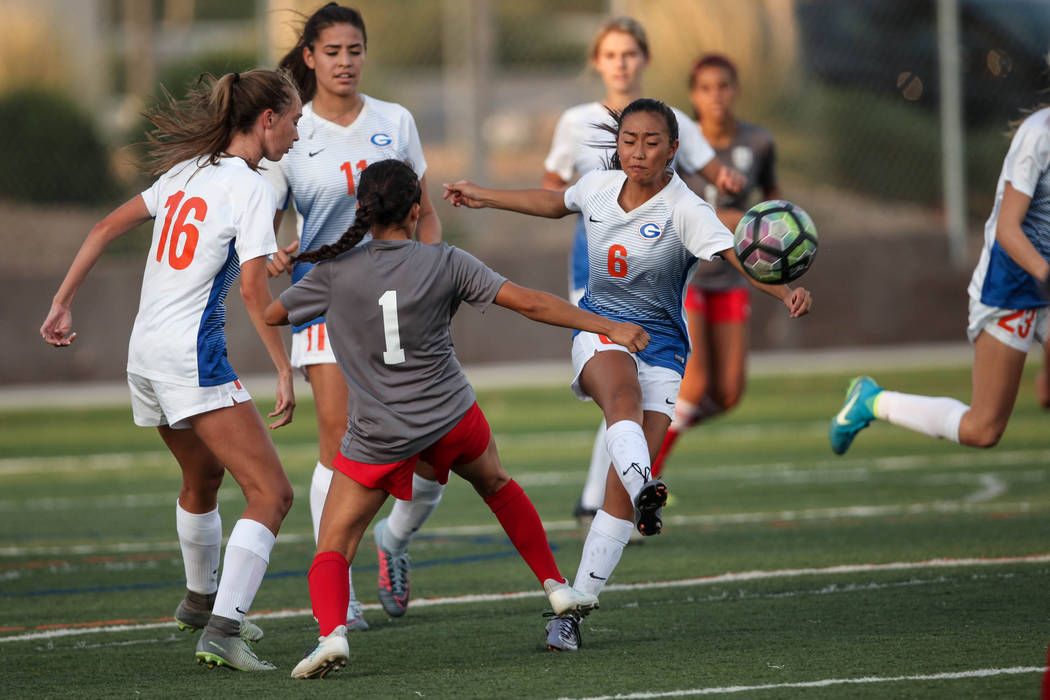 Bishop Gorman's Caitlyn Rueca, 6, lobs the ball during a game against Arbor View High School at Bishop Gorman High School in Las Vegas on Aug. 31, 2017. Bishop Gorman won 4-3. Joel Angel Juarez La ...