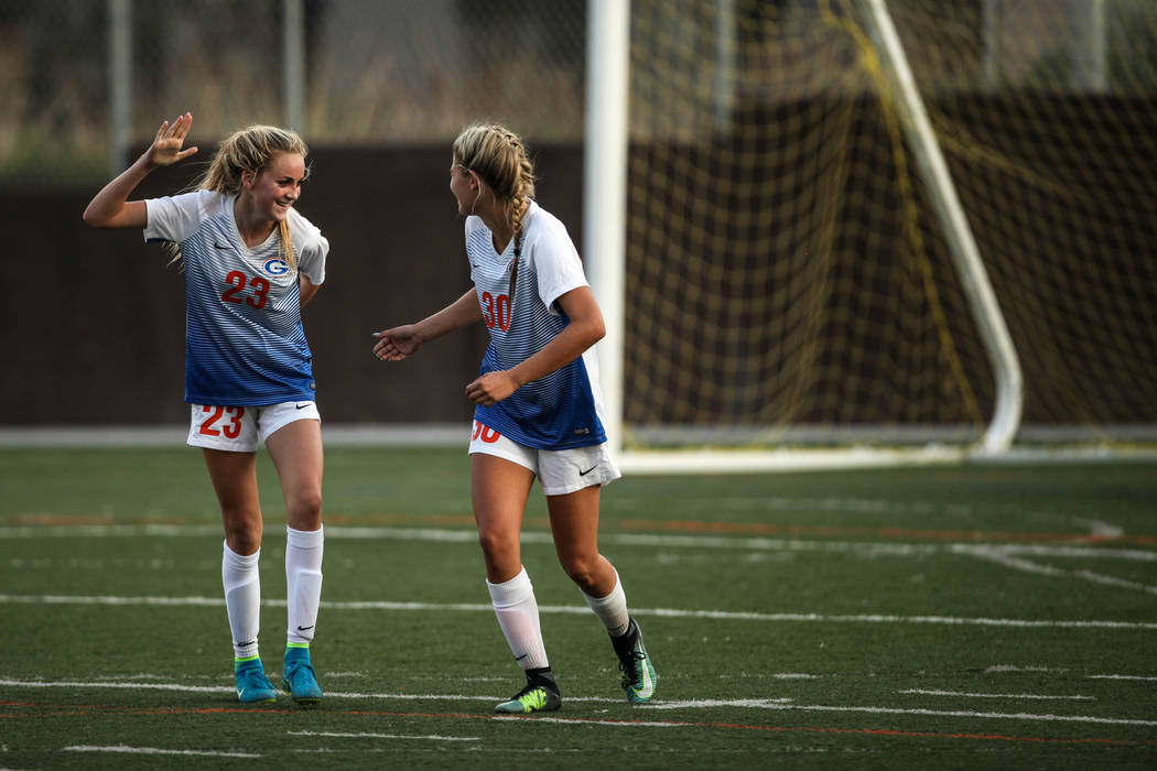 Bishop Gorman's Jacqueline Hillegas, 23, celebrates with Gianna Gourley, 30, after scoring a goal against Arbor View High School during a game at Bishop Gorman High School in Las Vegas on Aug. 31, ...