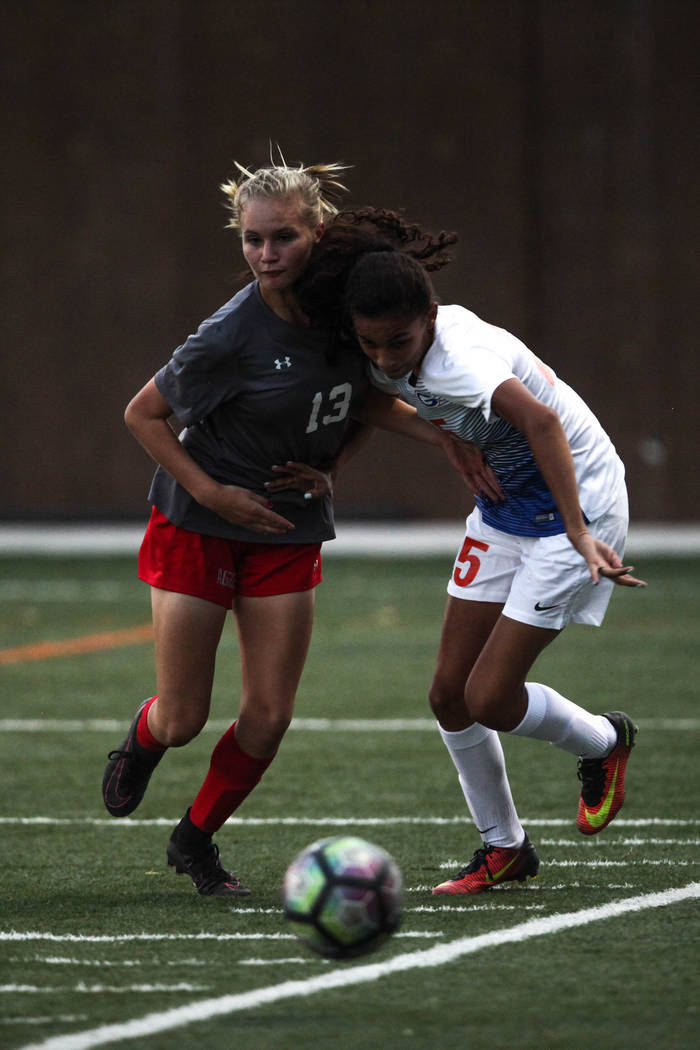 Arbor View High School's Jaylin Shoning, 13 and Bishop Gorman's Kenzie Carr, 5, fight over the ball during a game at Bishop Gorman High School in Las Vegas on Aug. 31, 2017. Bishop Gorman won 4-3. ...