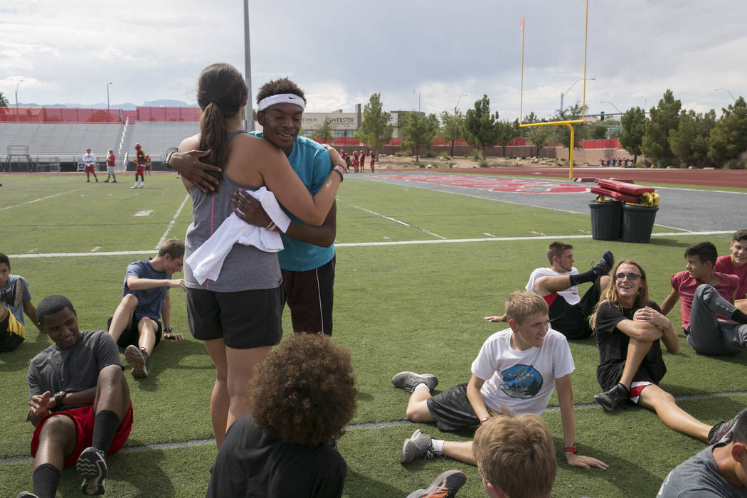 Arbor View varsity's Keith Williams accepts a runner of the week award from coach Sheina Torres during practice at Arbor View High School in Las Vegas, on Tuesday, Aug. 29, 2017.  Gabriella Angott ...