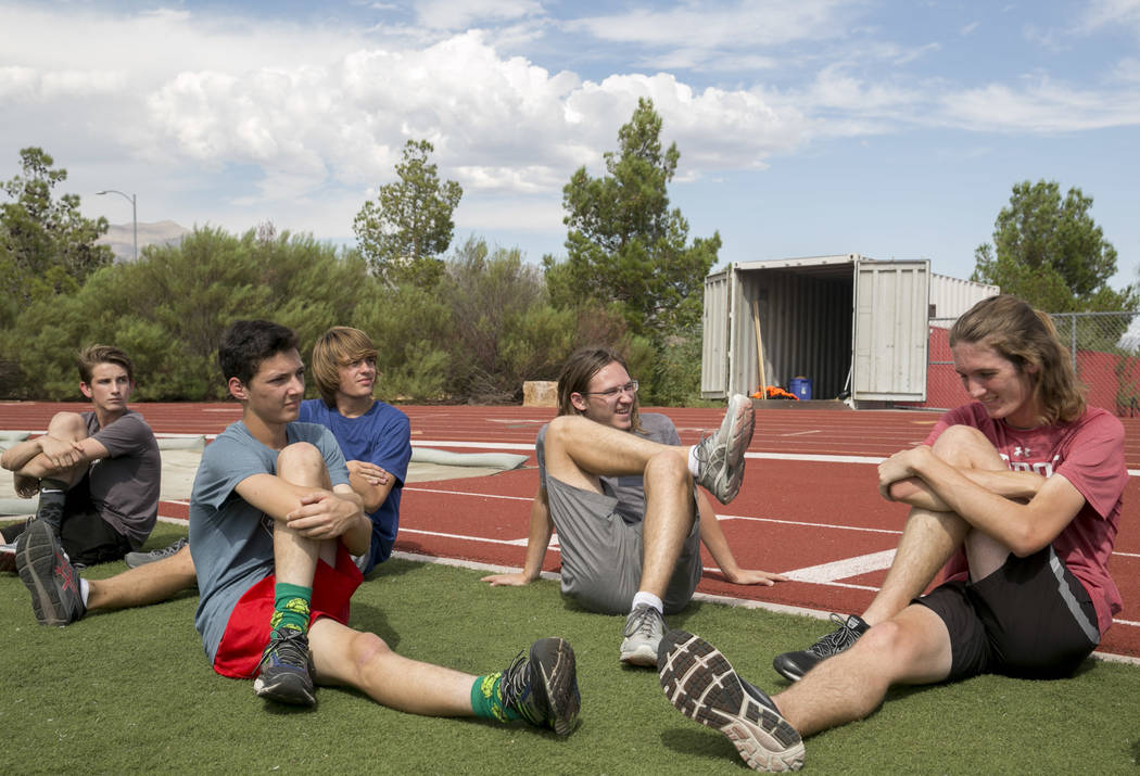 Arbor View varsity's Ian Jackson, center, who was a  first-team all-state cross country runner last year, stretches with his his teammates during practice at Arbor View High School in Las Vegas, o ...