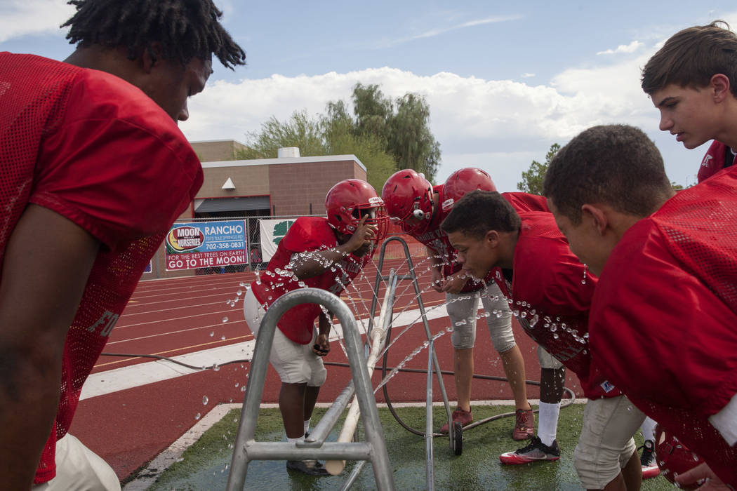 Members of the Arbor View High School football team take a water break during practice at Arbor View High School in Las Vegas, on Tuesday, Aug. 29, 2017.  Gabriella Angotti-Jones Las Vegas Review- ...