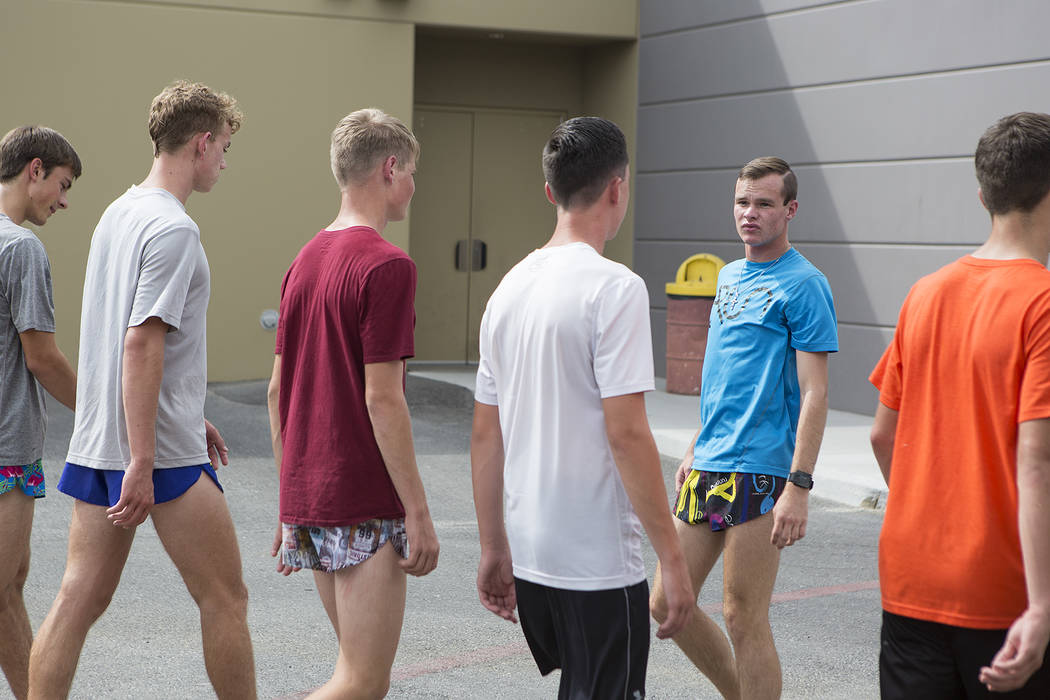 Pahrump cross country runner Bryce Odegard, second from right, walks backwards during a warmup at practice at Pahrump Valley High School on Tuesday, Sept. 5, 2017. Bridget Bennett Las Vegas Review ...