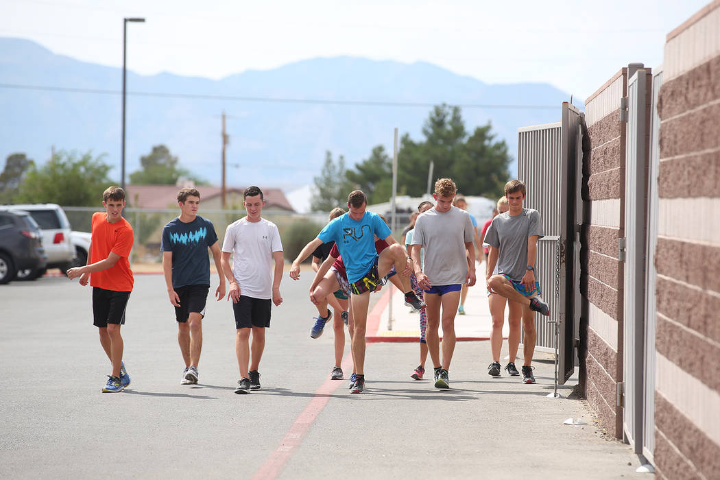 Pahrump cross country runner Bryce Odegard, third from right, warms up with teammates during practice at Pahrump Valley High School on Tuesday, Sept. 5, 2017. Bridget Bennett Las Vegas Review-Jour ...