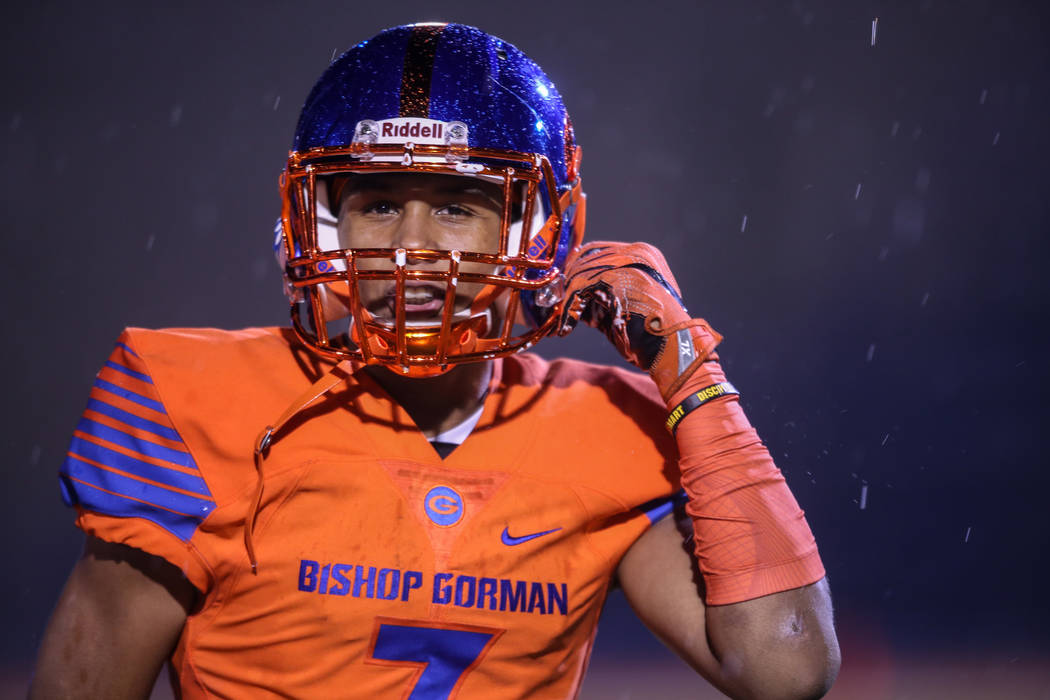 Bishop Gorman's Jordan Lee (7) clips his chin strap during a game against Miami Central at Bishop Gorman High School in Las Vegas, Friday, Sept. 8, 2017. Joel Angel Juarez Las Vegas Review-Journal ...