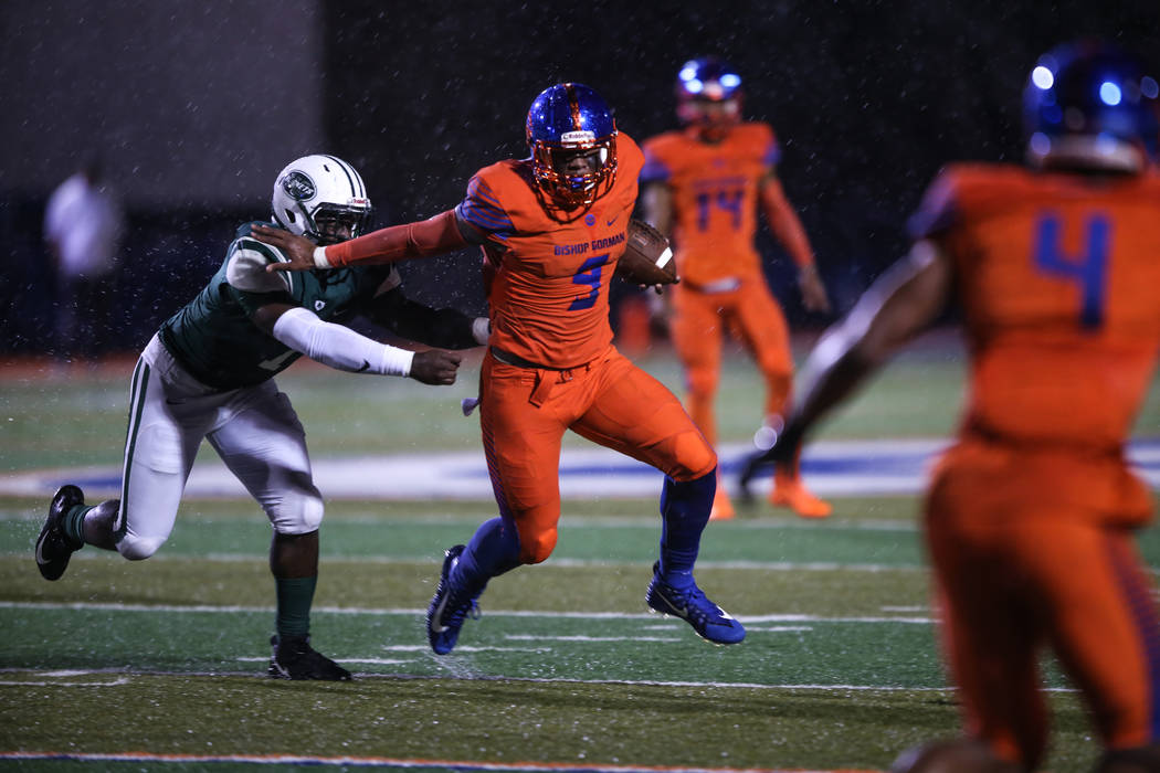 Bishop Gorman's Brevin Jordan (9) runs past Miami Central's Robert Hicks lll (1) during the first quarter at Bishop Gorman High School in Las Vegas, Friday, Sept. 8, 2017. Joel Angel Juarez Las Ve ...