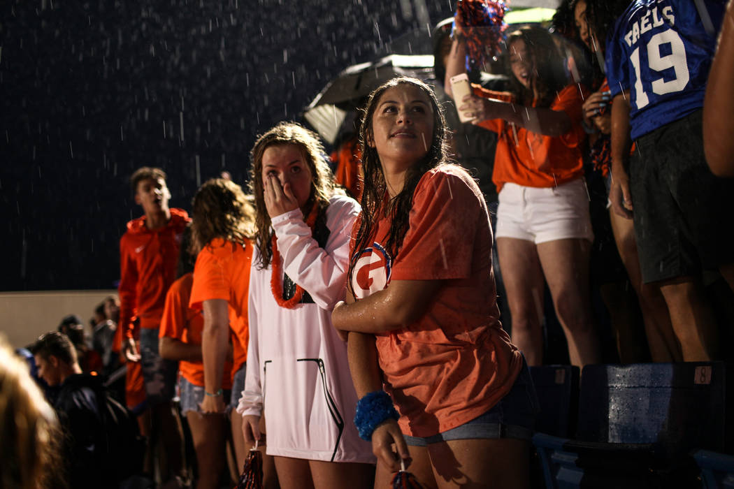 Hope Robertson, right, stands in the rain during a delay at the Bishop Gorman versus Miami Central football game at Bishop Gorman High School in Las Vegas, Friday, Sept. 8, 2017. Joel Angel Juarez ...
