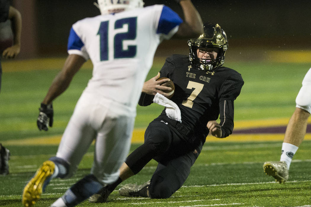 Faith Lutheran's quarterback Sagan Gronauer (7) slides for a gain of yards against Green Valley in the football game at Faith Lutheran Middle School and High School in Las Vegas, on Monday, Aug. 2 ...