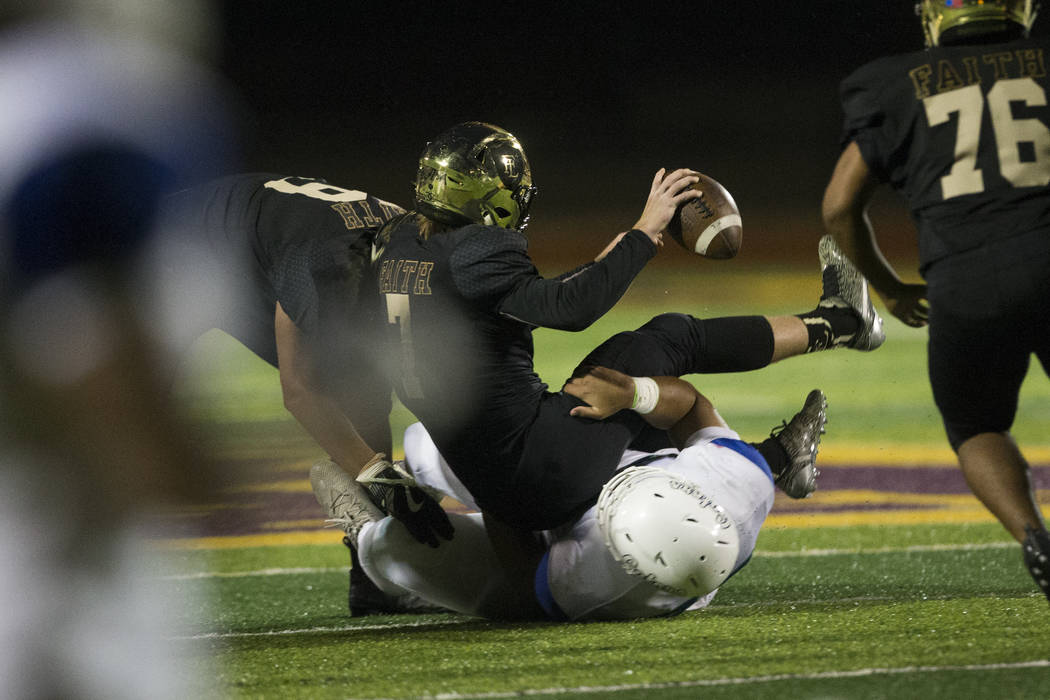 Faith Lutheran's quarterback Sagan Gronauer (7) is sacked by Green Valley's Jay Kakiva (55) in the football game at Faith Lutheran Middle School and High School in Las Vegas, on Monday, Aug. 21, 2 ...