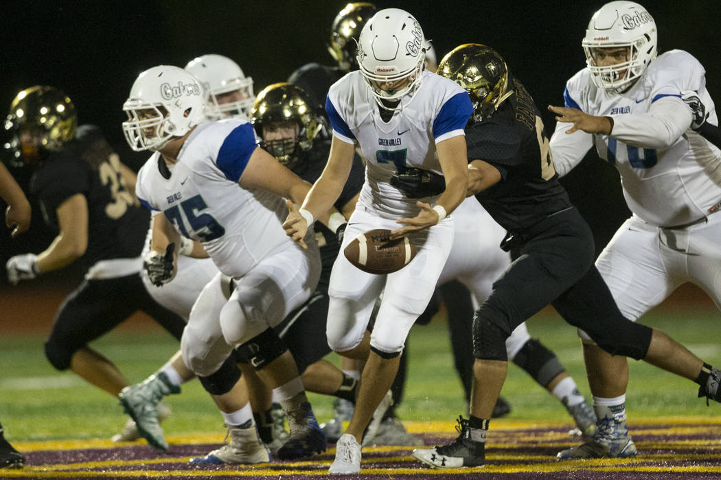 Green Valley's quarterback AJ Barilla fumbles the ball against Faith Lutheran in the football game at Faith Lutheran Middle School and High School in Las Vegas, on Monday, Aug. 21, 2017. Erik Verd ...