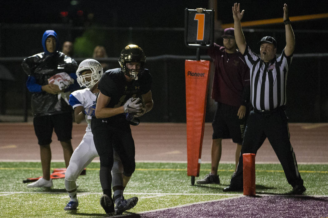 Faith Lutheran's Peyton Thornton (14) makes a catch for a touchdown against Green Valley in the football game at Faith Lutheran Middle School and High School in Las Vegas, on Monday, Aug. 21, 2017 ...