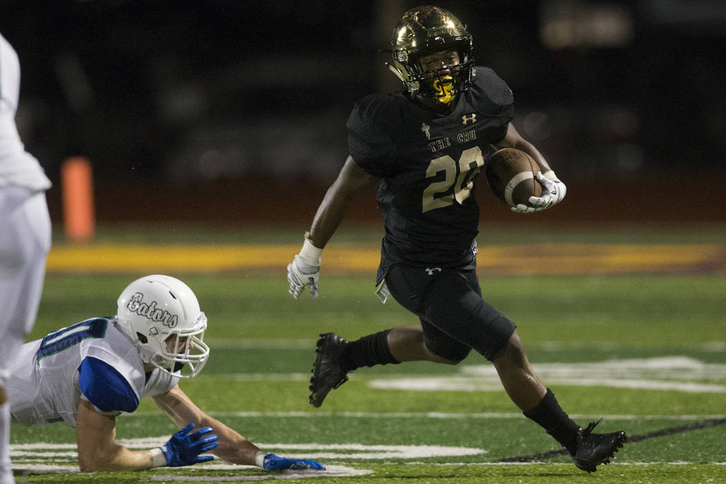 Faith Lutheran's Saundre Spiller (20) runs the ball against Green Valley in the football game at Faith Lutheran Middle School and High School in Las Vegas, on Monday, Aug. 21, 2017. Erik Verduzco  ...