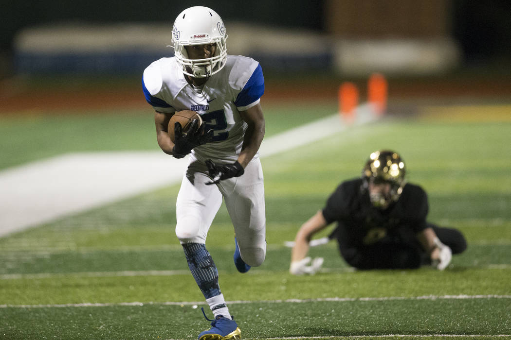 Green Valley's Israel Robinson (12) runs the ball after an interception against Faith Lutheran in the football game at Faith Lutheran Middle School and High School in Las Vegas, on Monday, Aug. 21 ...