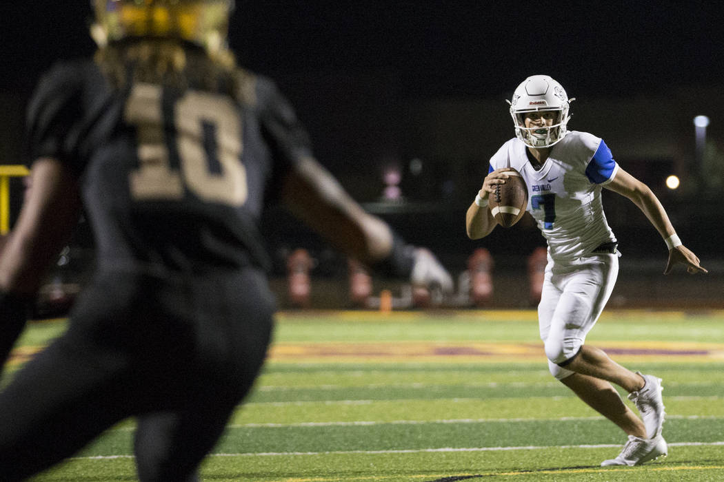 Green Valley's AJ Barilla (7) looks for an open pass against Faith Lutheran in the football game at Faith Lutheran Middle School and High School in Las Vegas, on Monday, Aug. 21, 2017. Erik Verduz ...