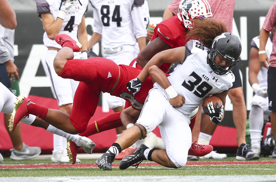 Alta's Tu'u Afu (39) is tackled by Liberty's Austin Fiaseu (8) during a football game at Sam Boyd Stadium in Las Vegas on Saturday, Sept. 9, 2017. Liberty won 28-7. Chase Stevens Las Vegas Review- ...
