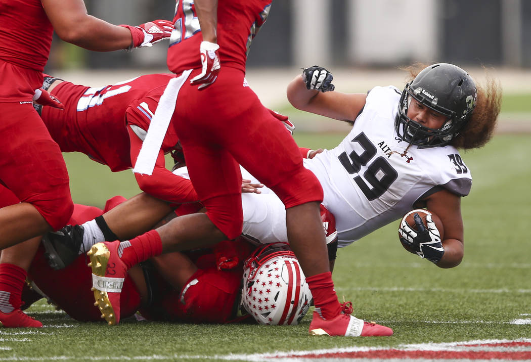 Alta's Tu'u Afu (39) is tackled by Liberty defense during a football game at Sam Boyd Stadium in Las Vegas on Saturday, Sept. 9, 2017. Liberty won 28-7. Chase Stevens Las Vegas Review-Journal @css ...