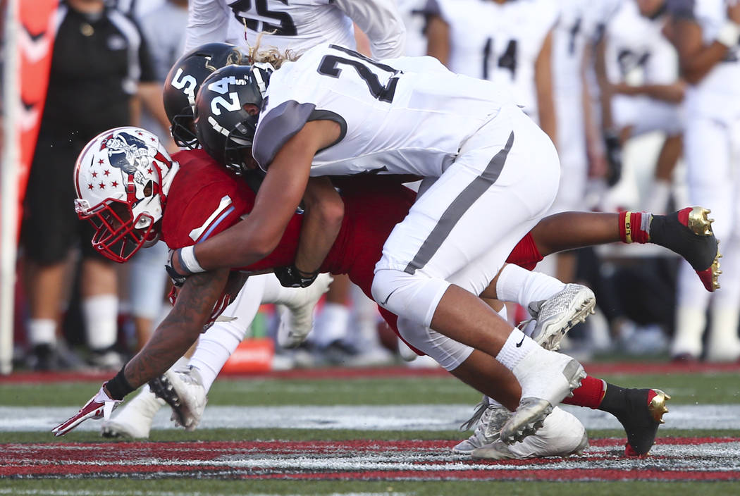 Liberty's Kishon Pitts (25) is tackled by Alta's Siaosi Niumeitolu (24) during a football game at Sam Boyd Stadium in Las Vegas on Saturday, Sept. 9, 2017. Liberty won 28-7. Chase Stevens Las Vega ...