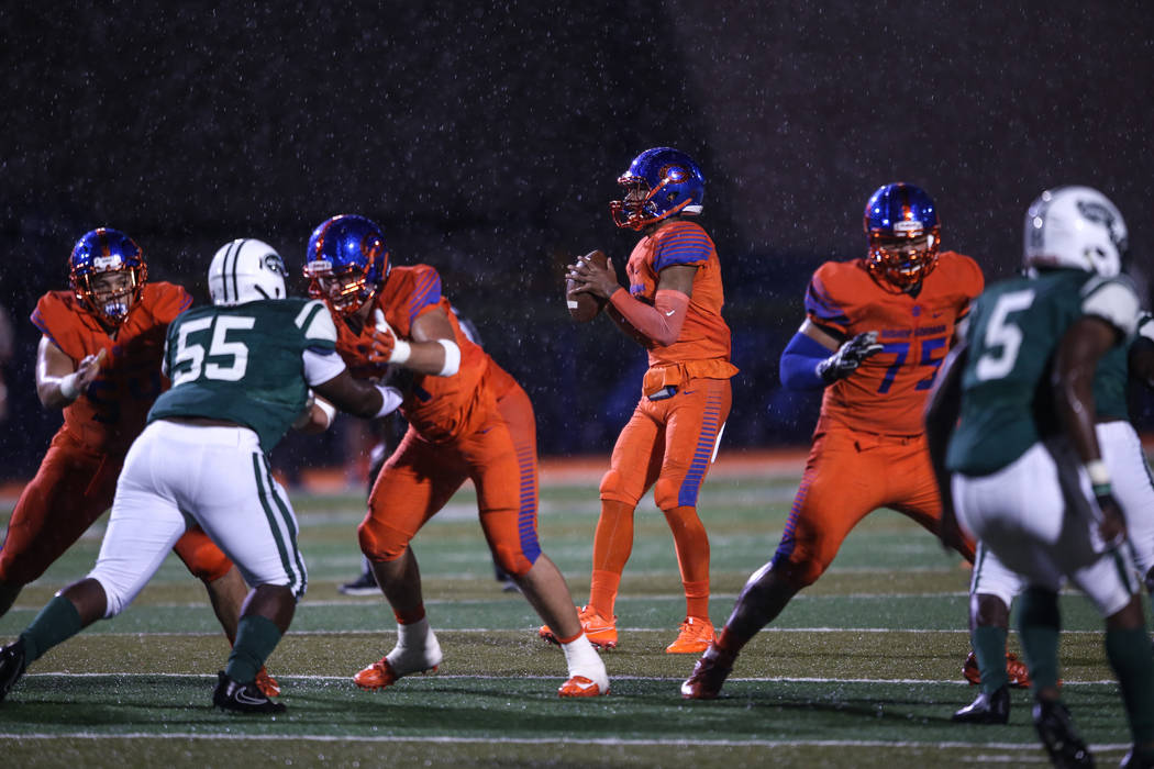Bishop Gorman's Dorian Thompson-Robinson (14) prepares to throw a pass against Miami Central during the first quarter at Bishop Gorman High School in Las Vegas, Friday, Sept. 8, 2017. Joel Angel J ...