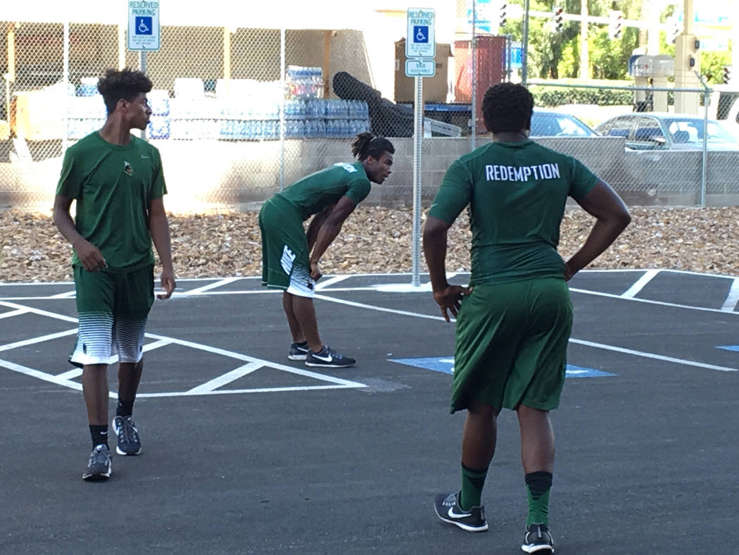 Members of the Miami Central High School football team practice in a parking across from the Westgate hotel after the football team was stranded in Las Vegas because of Hurricane Irma on Monday, S ...