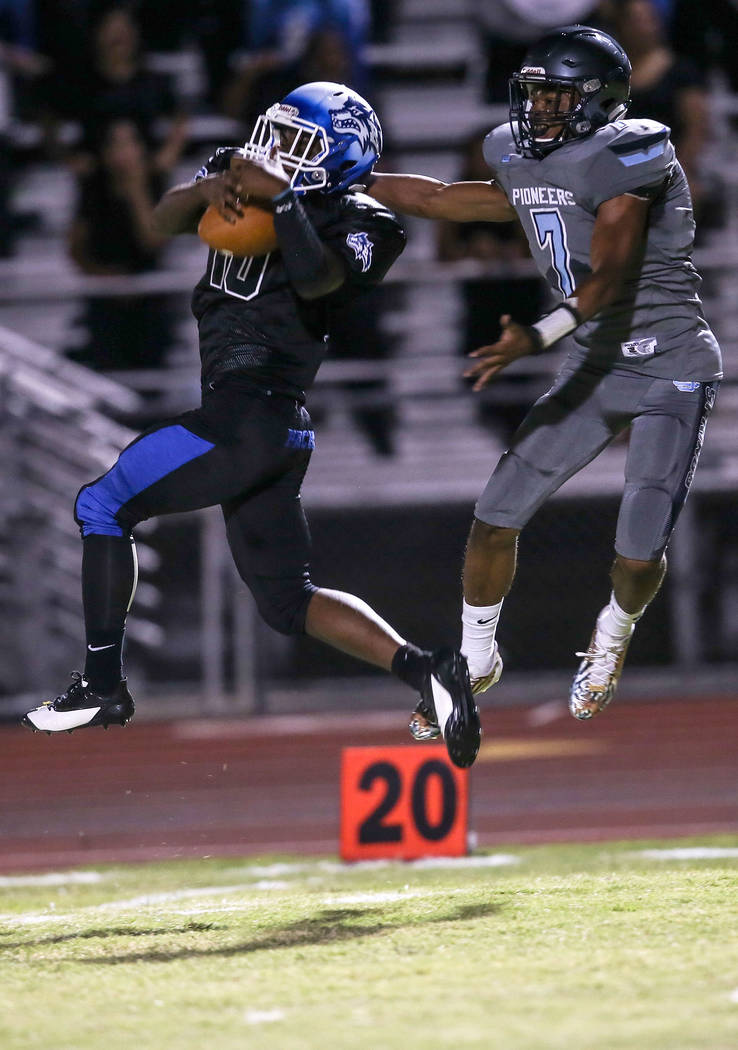 Basic's Franco Mays Jr. (10) intercepts a ball from Canyon Springs' Johnathan Bailey (7) during the first quarter of a football game at Basic High School in Henderson, Friday, Sept. 15, 2017. Joel ...