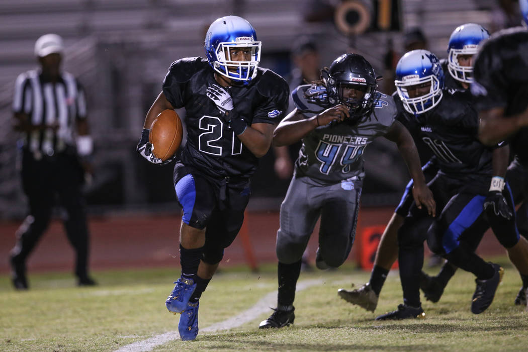 Basic's Dorian Ivan McAllister (21) runs the ball against Canyon Springs during the second quarter of a football game at Basic High School in Henderson, Friday, Sept. 15, 2017. Joel Angel Juarez L ...