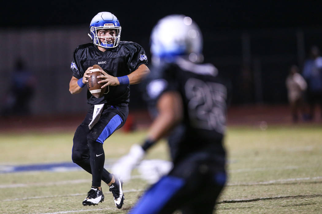 Basic's Paul Myro IV (3) prepares to throw a pass against Canyon Springs during the second quarter of a football game at Basic High School in Henderson, Friday, Sept. 15, 2017. Joel Angel Juarez L ...