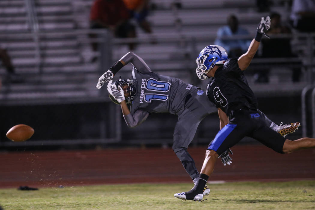 Canyon Springs' Keyon White (10) is blocked by Basic's Daniel Paonessa (9) during the second quarter of a football game at Basic High School in Henderson, Friday, Sept. 15, 2017. Joel Angel Juarez ...