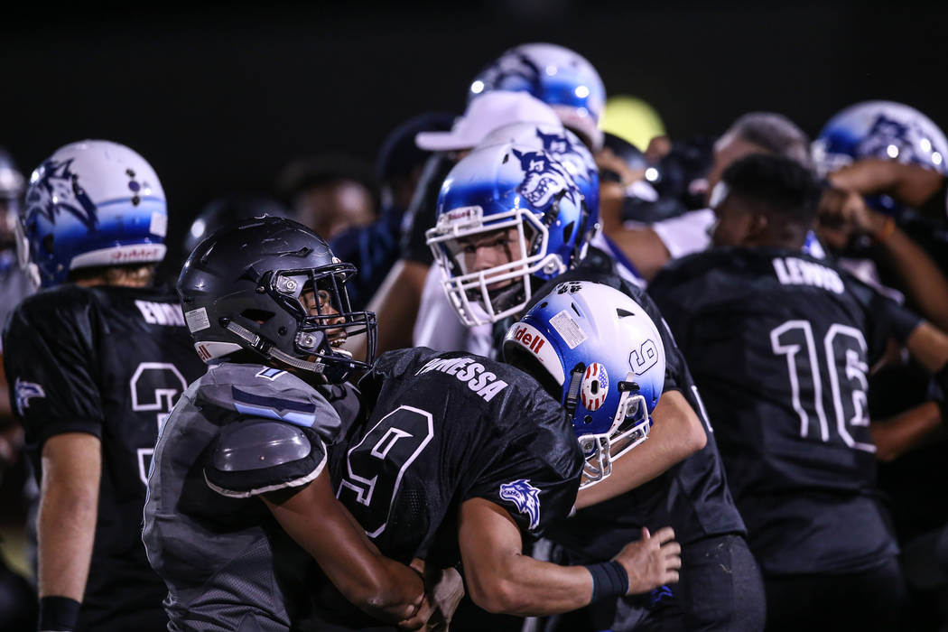 Canyon Springs' Johnathan Bailey (7) fights Basic's Daniel Paonessa (9) as a brawl broke out at the end of a football game at Basic High School in Henderson, Friday, Sept. 15, 2017. Canyon Springs ...