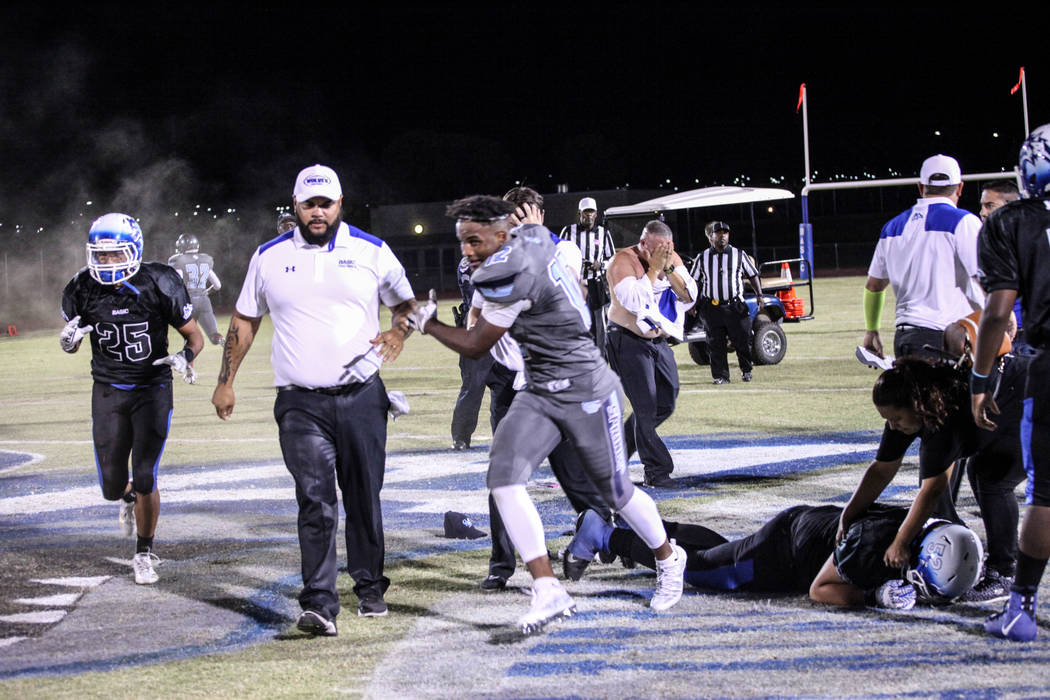 Police use pepper spray to disperse a fight between Canyon Springs and Basic football teams at the end of a game at Basic High School in Henderson, Friday, Sept. 15, 2017. Canyon Springs won 15-20 ...