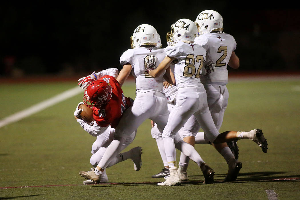 Faith Lutheran players attempt to tackle Arbor View player  Nathan Egbalic during the second half of the game at Arbor View High School on Friday, Sept. 15, 2017, in Las Vegas. Arbor View won 27-2 ...