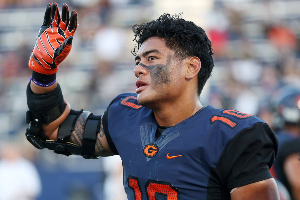 Bishop Gorman's Palaie Gaoteote waves to the stands prior to the start of the game against De La Salle at Bishop Gorman High School on Saturday, Sept. 16, 2017, in Las Vegas.  Bridget Bennett Las  ...