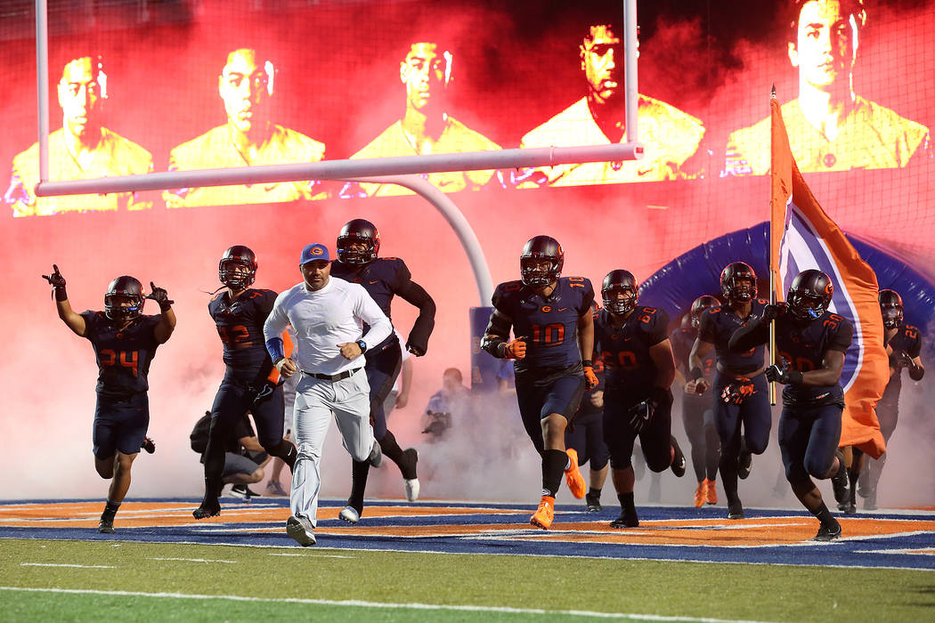 Bishop Gorman head coach Kenny Sanchez runs onto the field with his players prior to the start of the game against against De La Salle at Bishop Gorman High School on Saturday, Sept. 16, 2017, in  ...