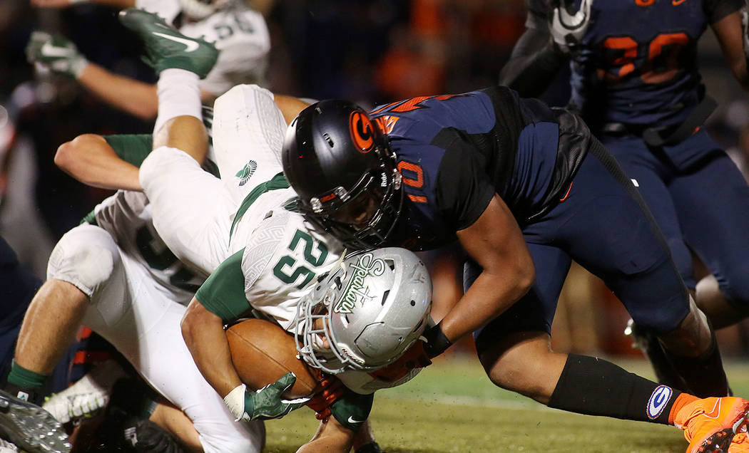 Bishop Gorman player Palaie Gaoteote (10) tackles De La Salle player Kairee Robinson (25) during the first half of the game at Bishop Gorman High School on Saturday, Sept. 16, 2017, in Las Vegas.  ...