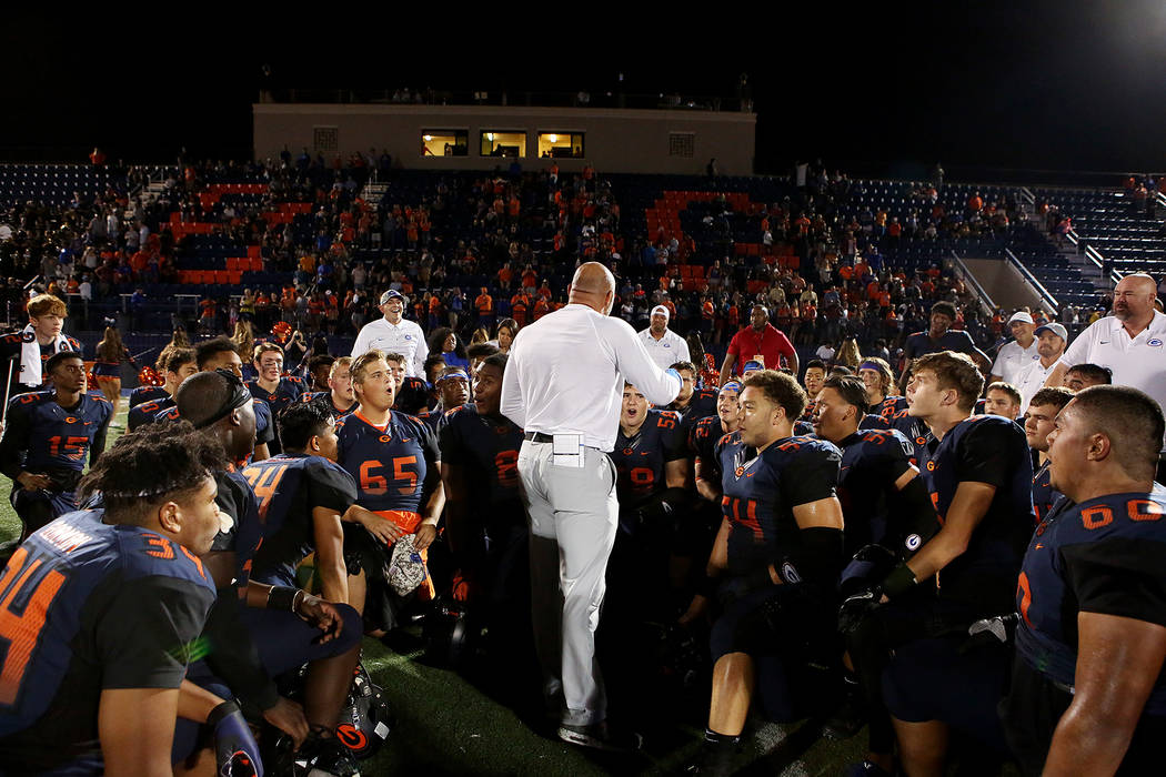 Bishop Gorman head coach Kenny Sanchez, center, talks to players after their 34-7 win over De La Salle at Bishop Gorman High School on Saturday, Sept. 16, 2017, in Las Vegas.   Bridget Bennett Las ...