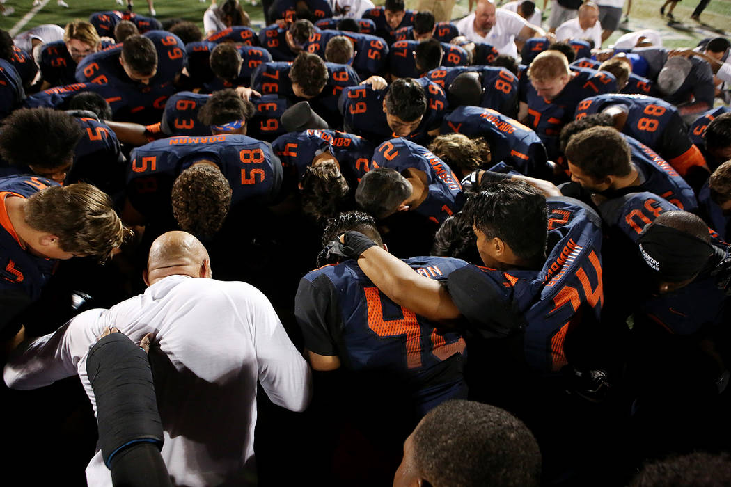 Bishop Gorman players say a prayer after their 34-7 win over De La Salle at Bishop Gorman High School on Saturday, Sept. 16, 2017, in Las Vegas.   Bridget Bennett Las Vegas Review-Journal @bridget ...