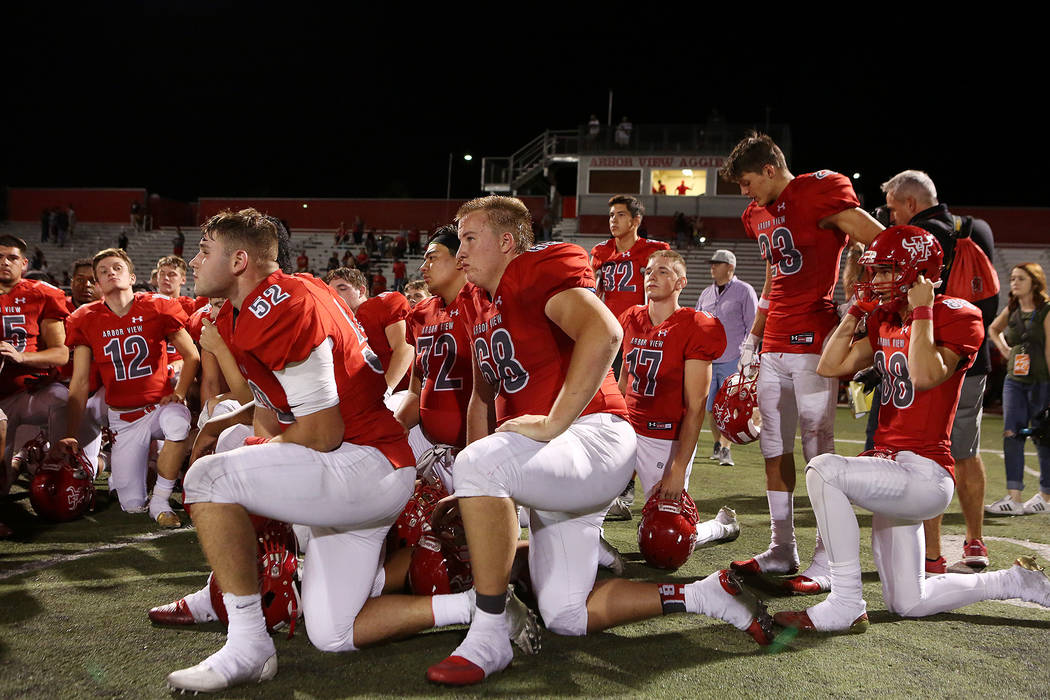 Arbor View take a knee after their 27-24 win over Faith Lutheran at Arbor View High School on Friday, Sept. 15, 2017, in Las Vegas. Arbor View won   Bridget Bennett Las Vegas Review-Journal @bridg ...