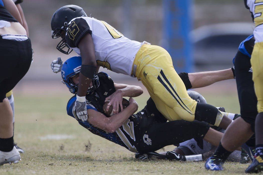 Sierra Vista's Trevor Gentner (12) is sacked by Clark's Antwan McClure (15) in their football game at Sierra Vista High School in Las Vegas, Saturday, Sept. 23, 2017. Sierra Vista won 49-14. Erik  ...