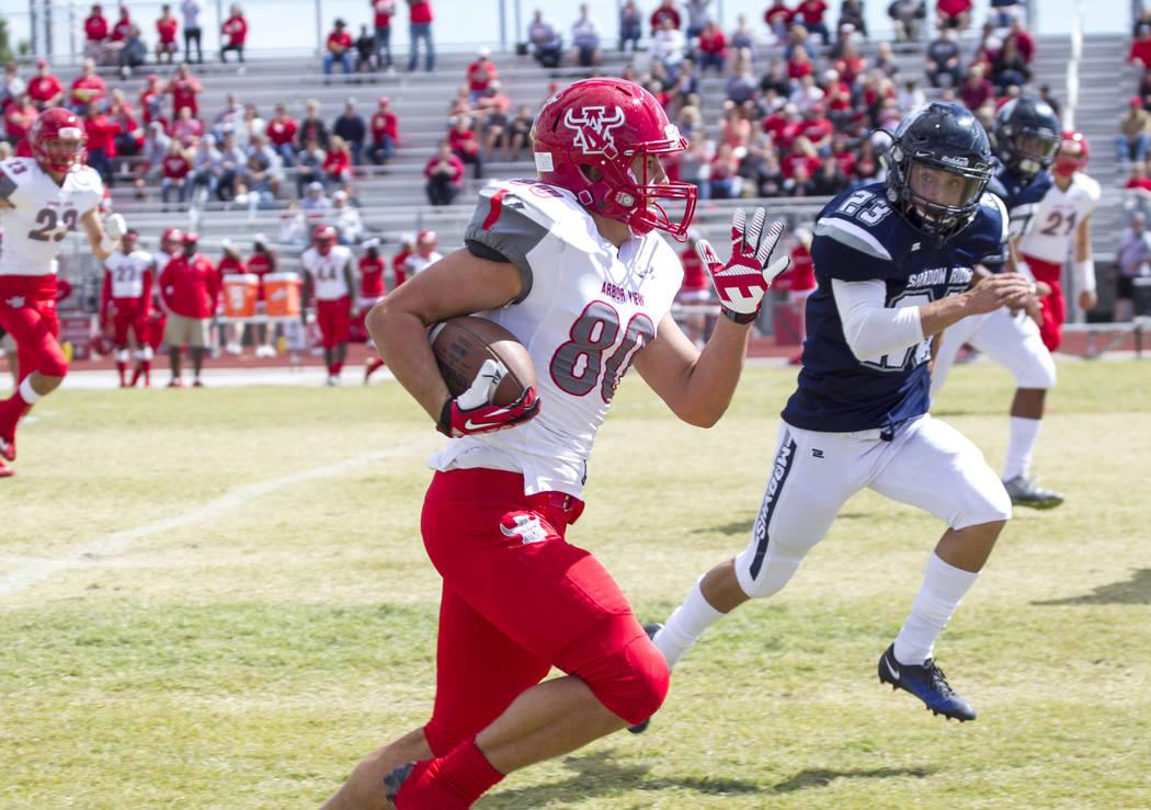Arbor View's Mason Tucker (80) runs the ball against Shadow Ridge during a football game at Shadow Ridge High School on Saturday, Sept. 23, 2017, in Las Vegas. Richard Brian Las Vegas Review-Journ ...