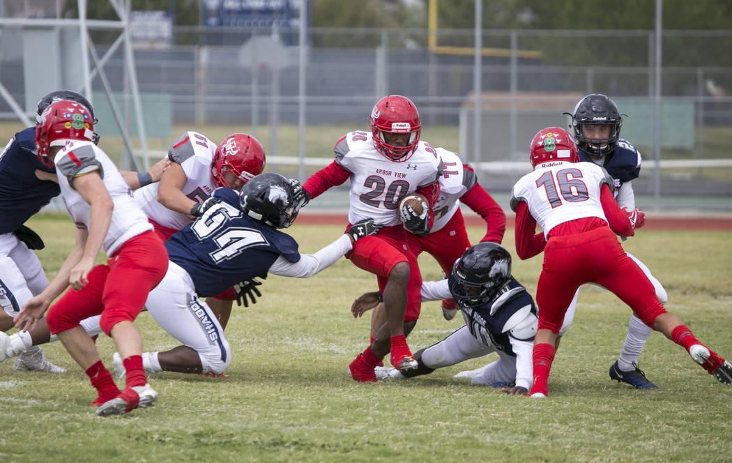 Arbor View's Jaquari Hannie (20) breaks through Shadow Ridge defense during a football game at Shadow Ridge High School on Saturday, Sept. 23, 2017, in Las Vegas. Richard Brian Las Vegas Review-Jo ...