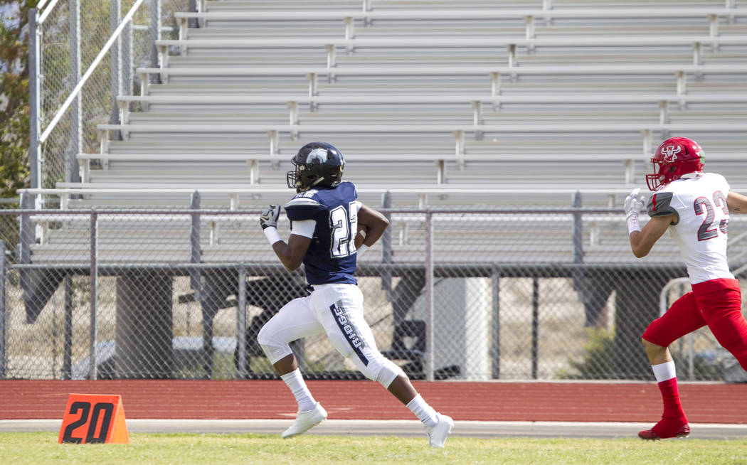 Shadow Ridge's Aubrey Nellems (22) breaks away from Arbor View's Deago Stubbs (23) for a touchdown during a football game at Shadow Ridge High School on Saturday, Sept. 23, 2017, in Las Vegas. Ric ...