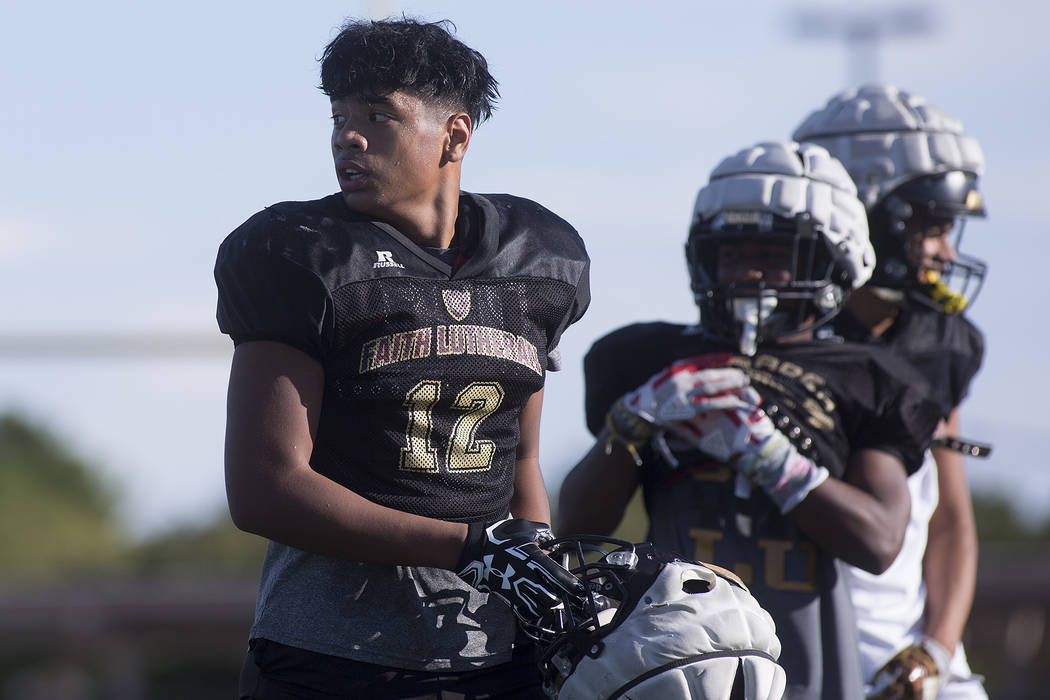 Faith Lutheran football player Ma'a Gaoteote takes off his helmet for a water break during a practice at Faith Lutheran High School in Las Vegas, Tuesday, Sept. 26, 2017. Bridget Bennett Las Vegas ...