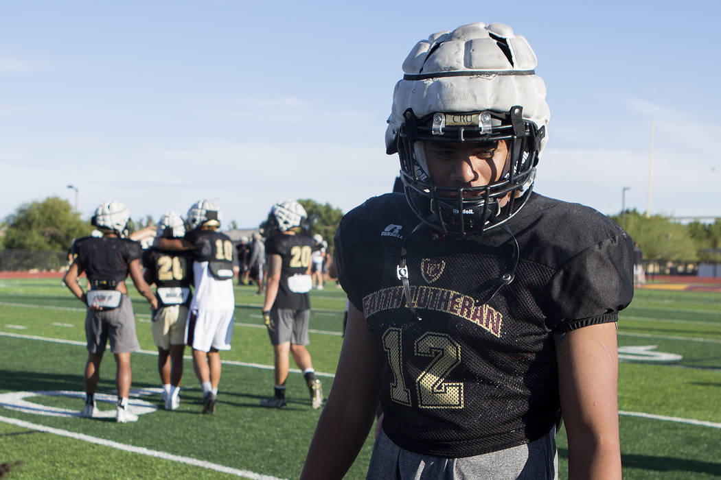 Faith Lutheran football player Ma'a Gaoteote talks with teammates during a practice at Faith Lutheran High School in Las Vegas, Tuesday, Sept. 26, 2017. Bridget Bennett Las Vegas Review-Journal @B ...