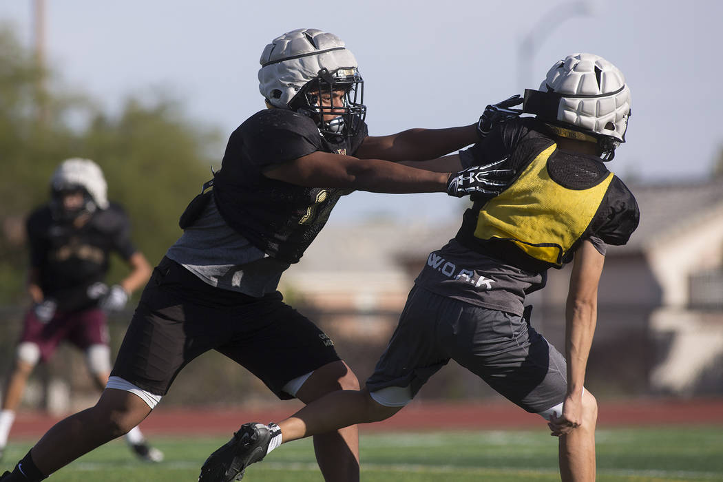 Faith Lutheran football player Ma'a Gaoteote, left, runs plays with teammates during a practice at Faith Lutheran High School in Las Vegas, Tuesday, Sept. 26, 2017. Bridget Bennett Las Vegas Revie ...