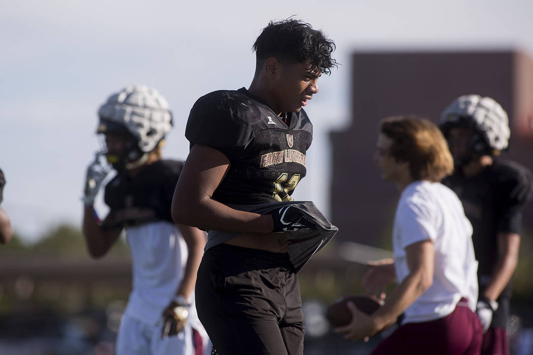 Faith Lutheran football player Ma'a Gaoteote takes a break after a drill during a practice at Faith Lutheran High School in Las Vegas, Tuesday, Sept. 26, 2017. Bridget Bennett Las Vegas Review-Jou ...