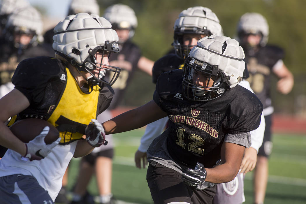 Faith Lutheran football player Ma'a Gaoteote, right, runs plays with teammates during a practice at Faith Lutheran High School in Las Vegas, Tuesday, Sept. 26, 2017. Bridget Bennett Las Vegas Revi ...