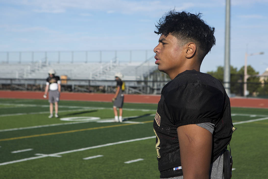 Faith Lutheran football player Ma'a Gaoteote takes off his helmet for a break between drills during a practice at Faith Lutheran High School in Las Vegas, Tuesday, Sept. 26, 2017. Bridget Bennett  ...