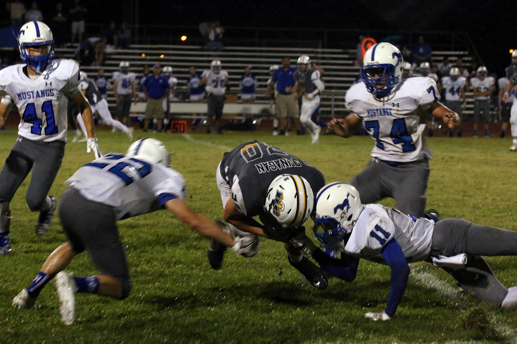 Boulder City High School junior Jimmy Dunagan generated 50 yards on 13 carries, trying to help the Eagles, which were playing without their leading rusher on Friday. BCHS lost 34-17 to Needles. Br ...