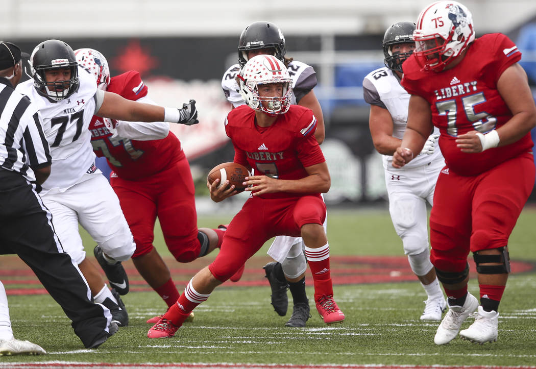 Liberty's Kenyon Oblad (7) runs the ball against Alta during a football game at Sam Boyd Stadium in Las Vegas on Saturday, Sept. 9, 2017. Liberty won 28-7. Chase Stevens Las Vegas Review-Journal @ ...